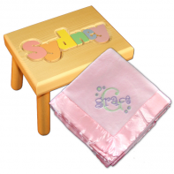 pastel stool and pink embroidered blanket